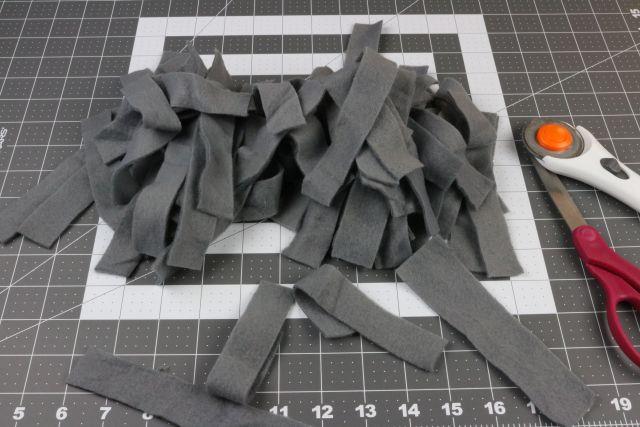 strips cut for DIY Dog Snuffle Mat